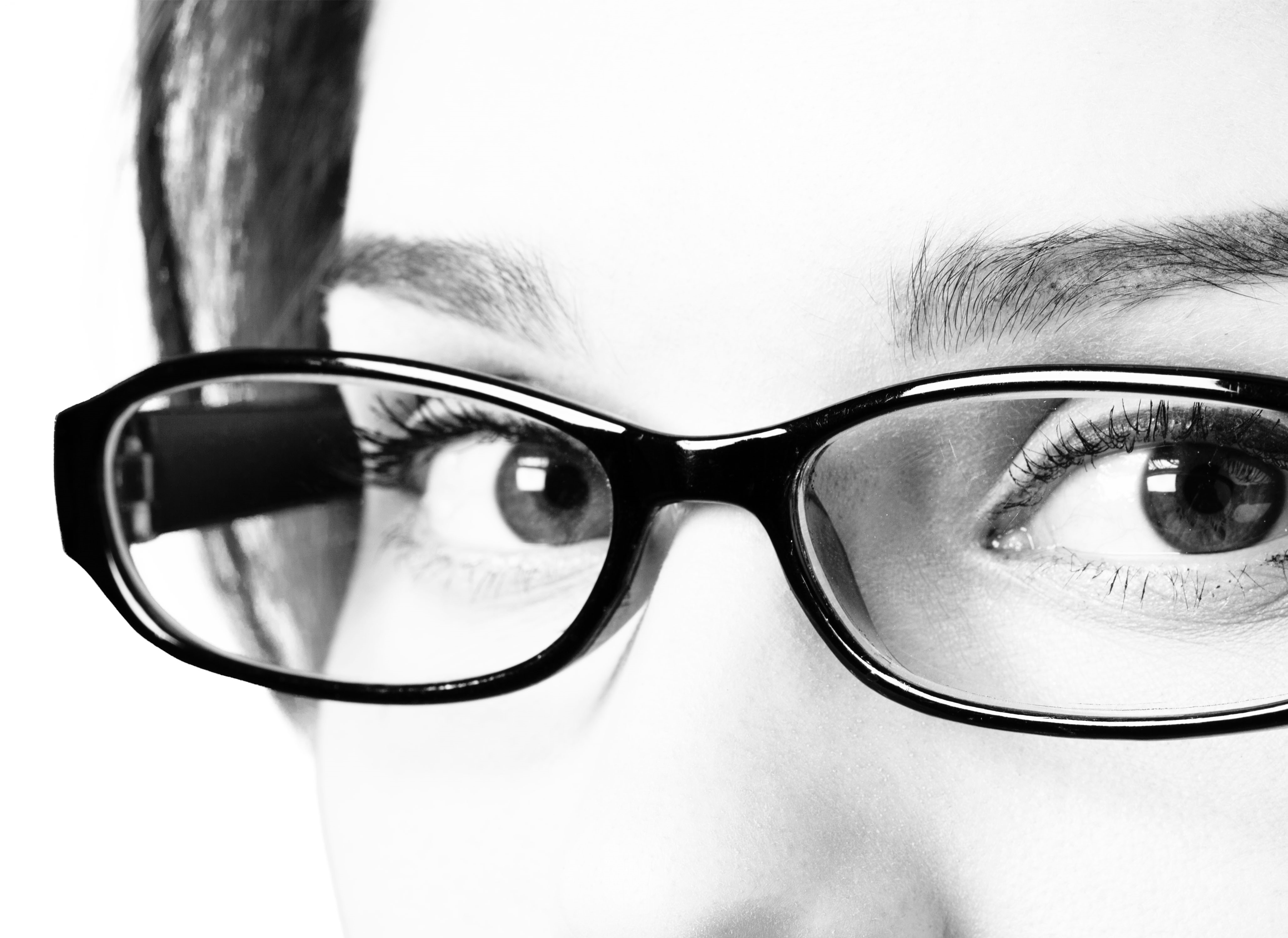woman with glasses - receiving quality eye care
